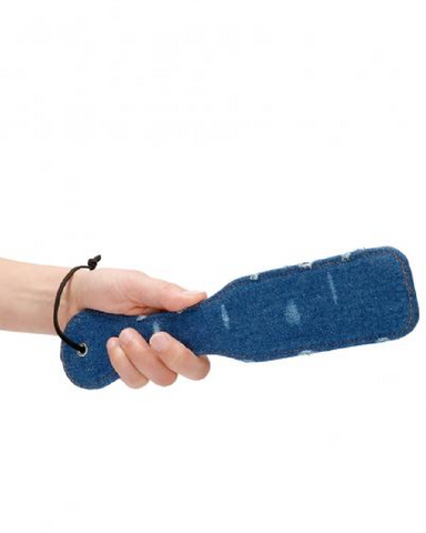model holding Ouch! Roughend Denim Style Paddle - Blue
