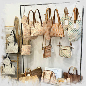 Collection of handmade bags displayed in store