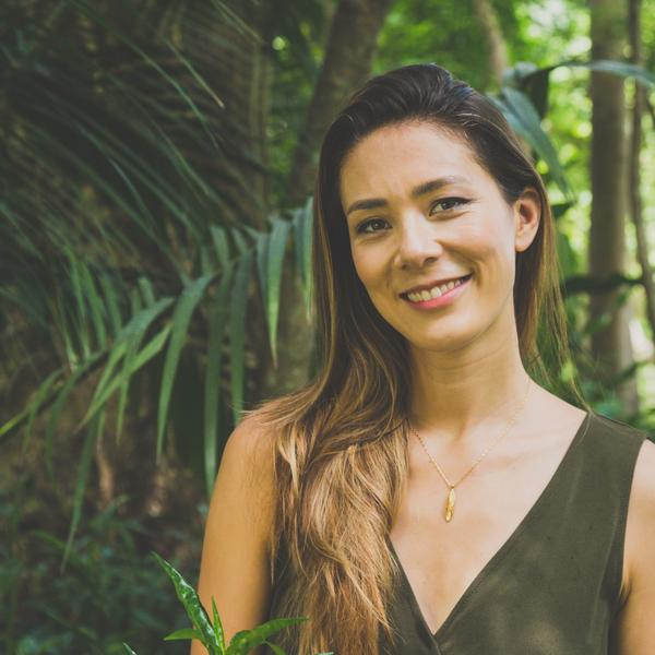 woman in a tropical forest wearing gold plated chrysalis pendant handing from a gold plated chain - Shop Ethical Jewellery & Fair Trade Gifts Melbourne at ONLY JUST