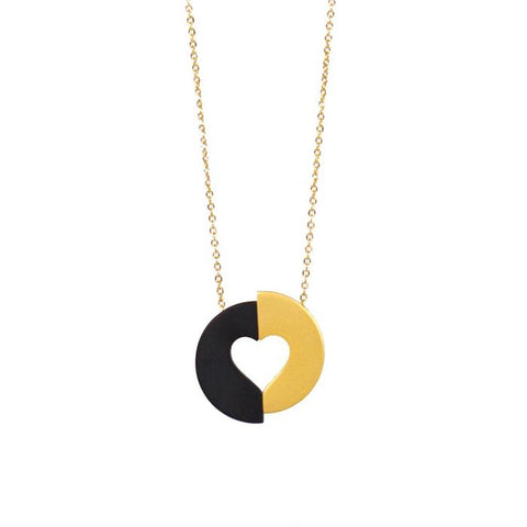Committed necklace. Gold and black heart pendant on gold chain