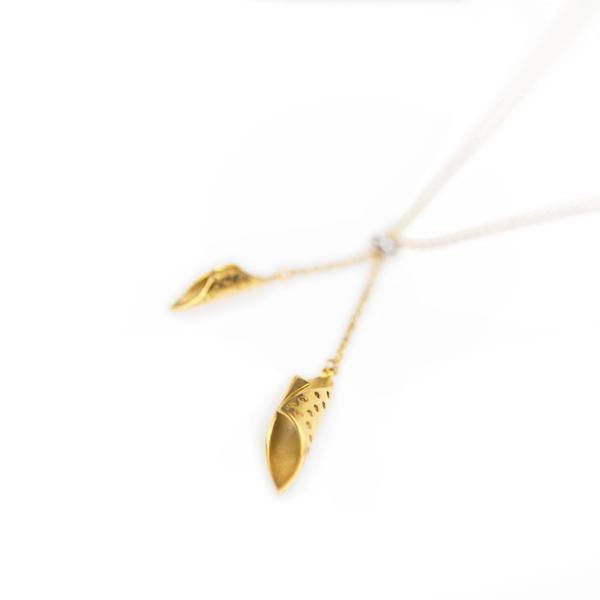 close-up detail of gold plated chrysalis pendants handing from a gold plated chain - Shop Ethical Jewellery & Fair Trade Gifts Melbourne at ONLY JUST