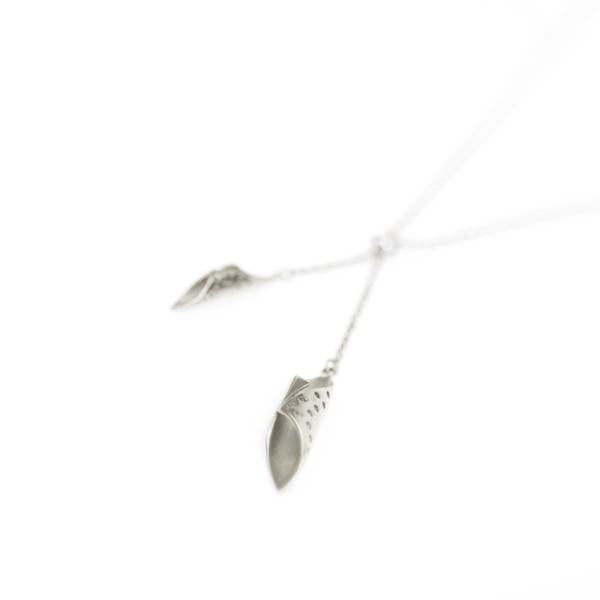 close-up detail of silver chrysalis pendants handing from a silver chain - Shop Ethical Jewellery & Fair Trade Gifts Melbourne at ONLY JUST