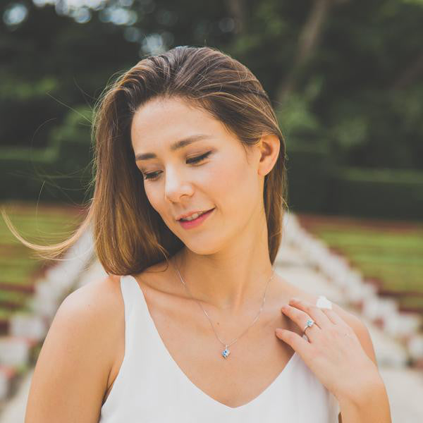 Brunette woman wearing silver Necklace with Blue Stone Pendant from Eden Salt and light collection - Shop Ethical Jewellery & Fair Trade Gifts Melbourne at ONLY JUST