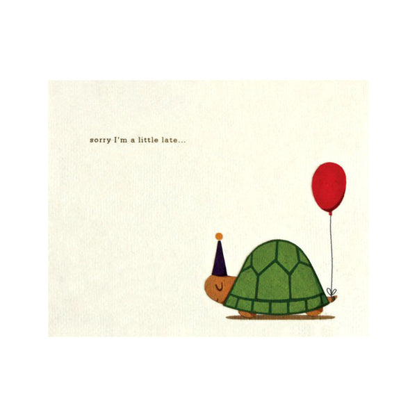 "Fair Trade handmade cream card depicting a turtle with red balloon attached from tail and wearing party hat. Message reads ""sorry I'm a little late..."""