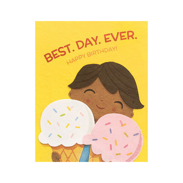 "Fair Trade handmade yellow card depicting a smiling child holding 2 large ice cream cones (white and pink) with sprinkles. Message in red reads ""best.day.ever. Happy birthday!"""