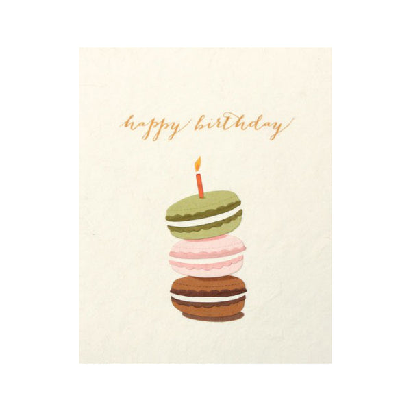 "Fair Trade handmade card depicting 3 macarons (chocolate, pink and green) in a stach with one candle on top. Message reads ""Happy birthday"""