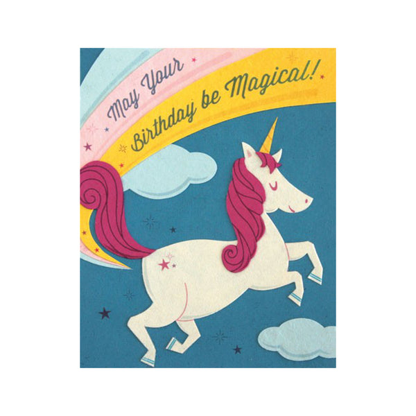 "Fair Trade handmade card depicting a white and pink unicorn in front of a rainbow. Message reads ""May your birthday be magical!"""