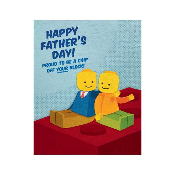 "Fair Trade handmade card depicting 2 sitting Lego figurines sitting on red Lego block. Message reads ""Happy Father's Day! Proud to be a chip off YOUR block!"""
