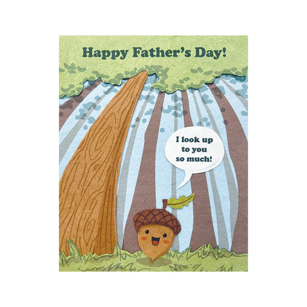 "Fair Trade handmade card depicting an acorn on forest ground surrounded by tall trees, saying:""I look up to you so much"". Main message reads ""Happy Father's Day!"""