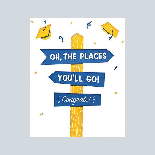 "Fair Trade handprinted card with yellow & blue mortar caps and signposts reading ""Oh, the places you'll go. Congrats"""