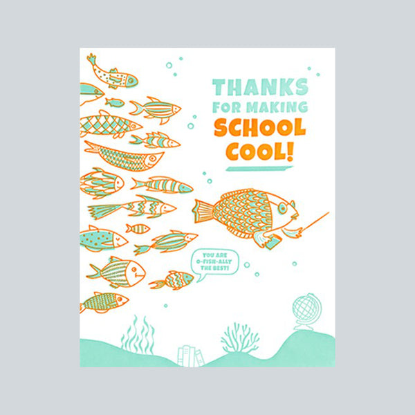 "Handprinted fair trade card depicting a school of fish in orange and aqua colours and the message ""Thanks for making school cool"""