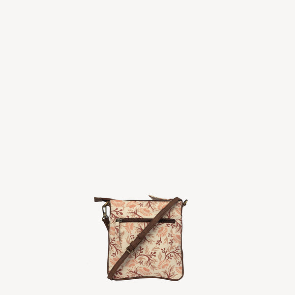 handmade joyn crossbody bag made with block printed cotton - spring floral pattern and tan leather details - Shop Joyn Fair Trade and Vegan Handbags at ONLY JUST