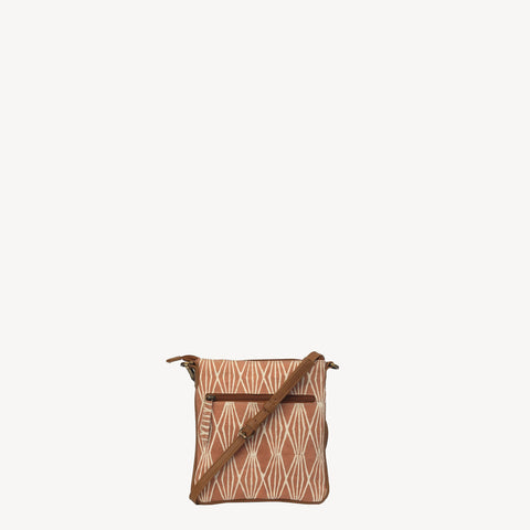 handmade joyn crossbody bag made with block printed cotton - saffron harvest pattern and tan leather details - Shop Joyn Fair Trade and Vegan Handbags at ONLY JUST