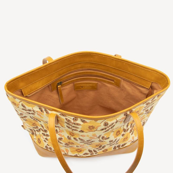 Inside view of golden blossoms tote bag showing cotton lining and zipped side pocket.