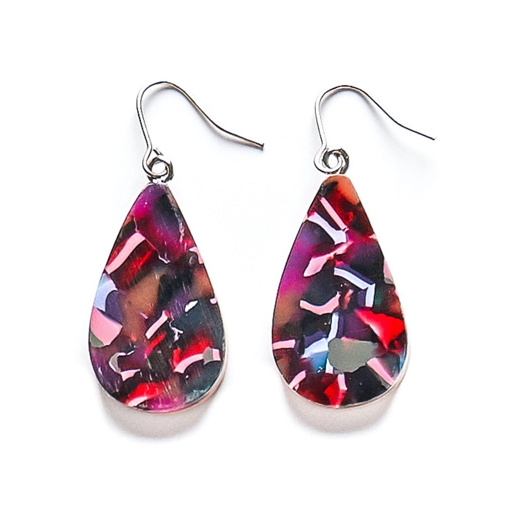 Colourful teardrop resin earrings in abstract navy, purple and pink patterns