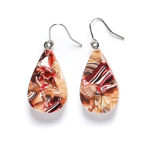 Colourful teardrop resin earrings in abstract red, brown and red patterns