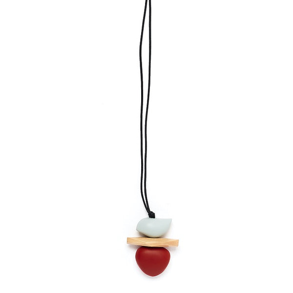 Wooden pendant with grey bird shape on natural wood plate and dark red pebble