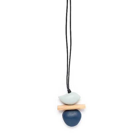 Wooden pendant with grey bird shape on natural wood plate and navy blue pebble