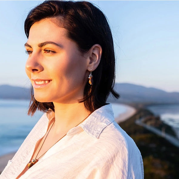 Model wearing Songbird earrings boobook owl - Shop Fair Trade, Handmade, Ethical Gifts & Jewellery Australia at ONLY JUST.