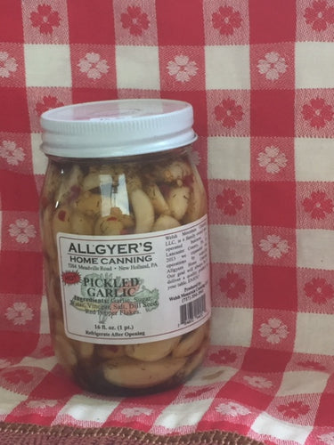 An image of a 16 oz. glass jar of hot pickled garlic