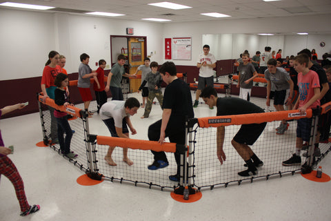 Students playing Octoball game in classroom