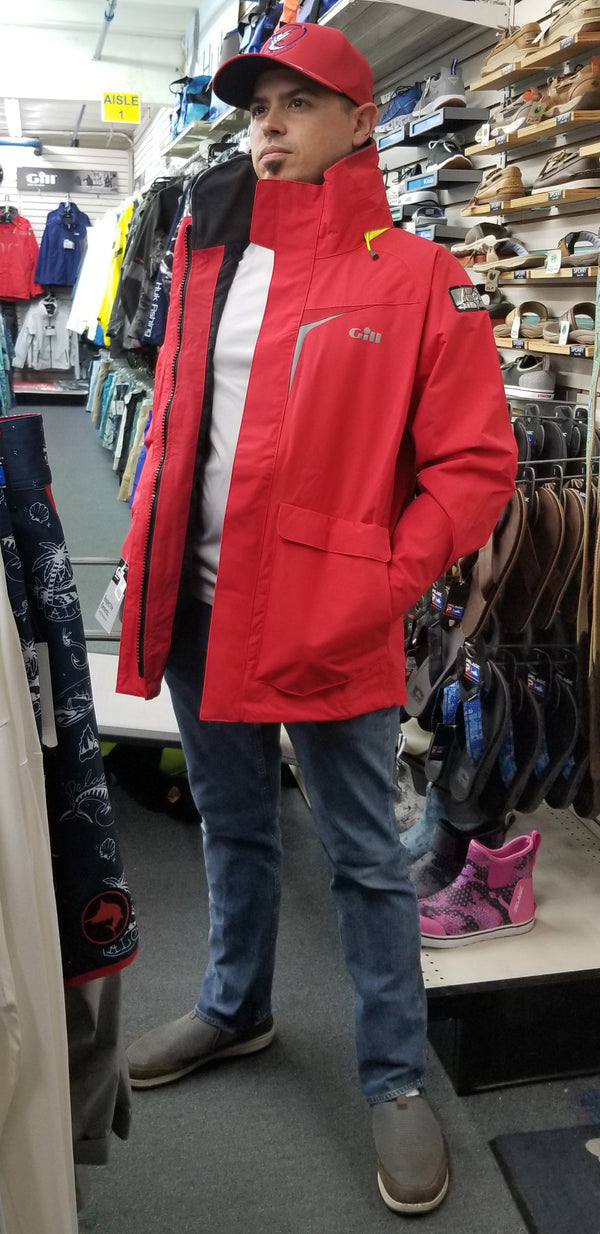 Danny sporting a red Gill jacket and Store hat