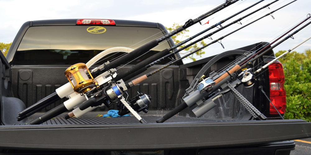 Two Rod Runner holders full of rods in the bed of a black truck.