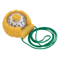 White numberical and lettered compass guage surrounded in yellow housing and green cord.