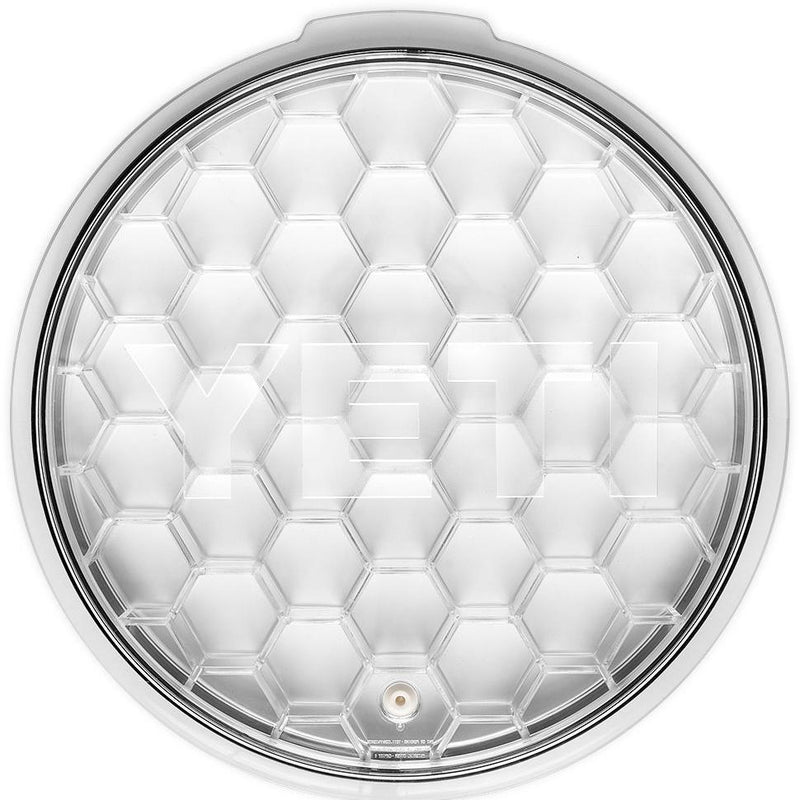Transparent circular lid with hexagonal pattern.