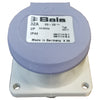 Small cylinder shaped electric plug with square base. Purple lid with label stating 32 AMP.