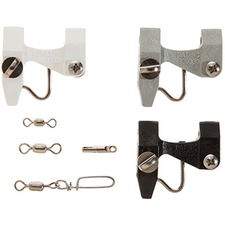 3 fishing release clips. One white, gray, and black next to 3 silver metal swivels