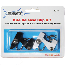 Two fishing release clips, one white and one black in original clear packaging
