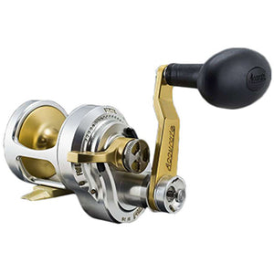 Silver reel with gold interior and gold arm with black handle and speed switch at the base of the arm.