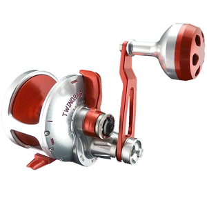 Sllver reel with red inside reel, arm, and lever. Face of handle is red, base of handle is silver. Speed switch located at the base of the arm.