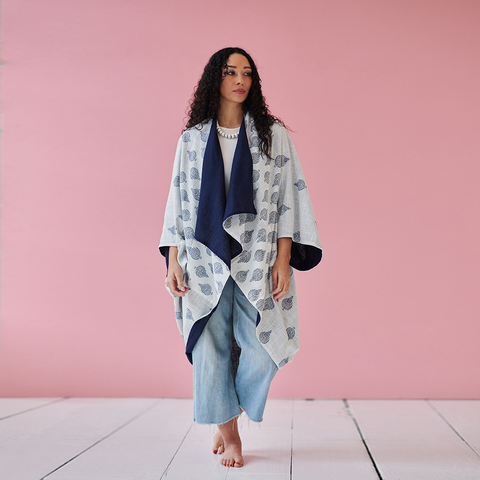 woman wearing blue and white block printed kimono with jeans