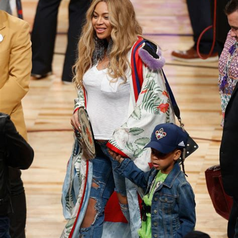 Beyonce with kimono and distressed jeans