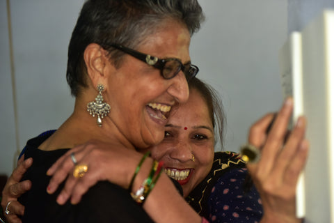 Parwa Devi weaver at Dev Bhumi gives Beena tai a hug