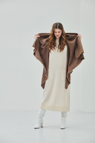 Julahas luxury women's poncho cape in pure wool to be styled in 15-in-one ways and perfect as a warm sylish sustainable clothing item for layering