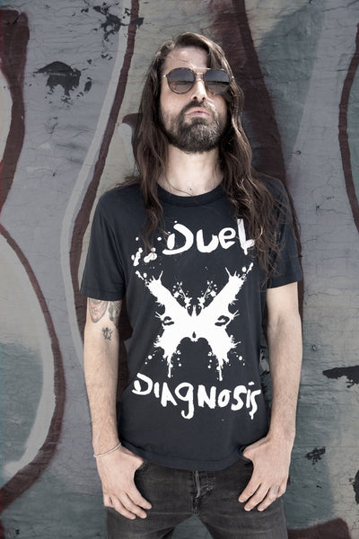 Duel Diagnosis black t-sirt with logo on the front in white and a man wearing it