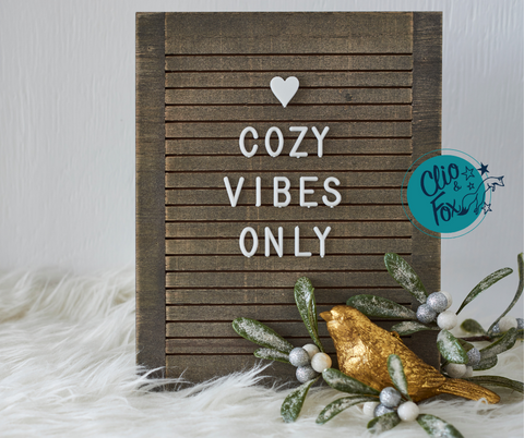 """Wood letter board with the message """"Cozy Vibes Only"""" with a gold bird and mistletoe"""