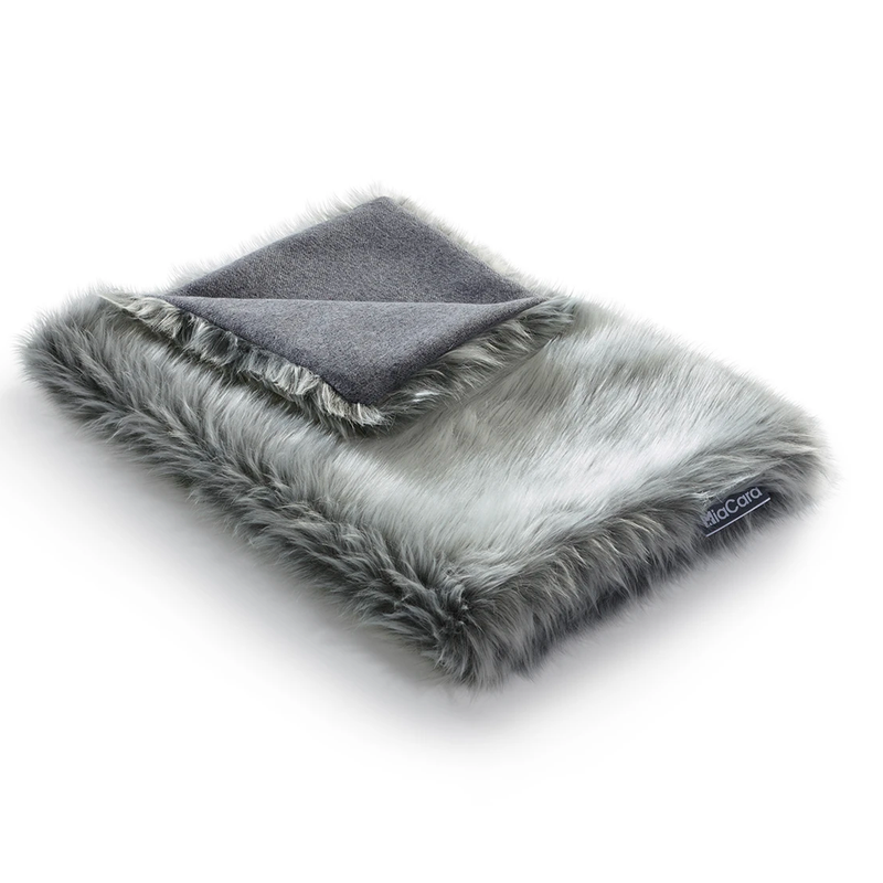 Washable cat blanket. Cats love snuggling into and kneading the fluffy sheepskin-like faux fur.