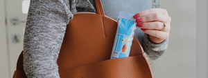 Women pulling out a keto snack bar from her bag