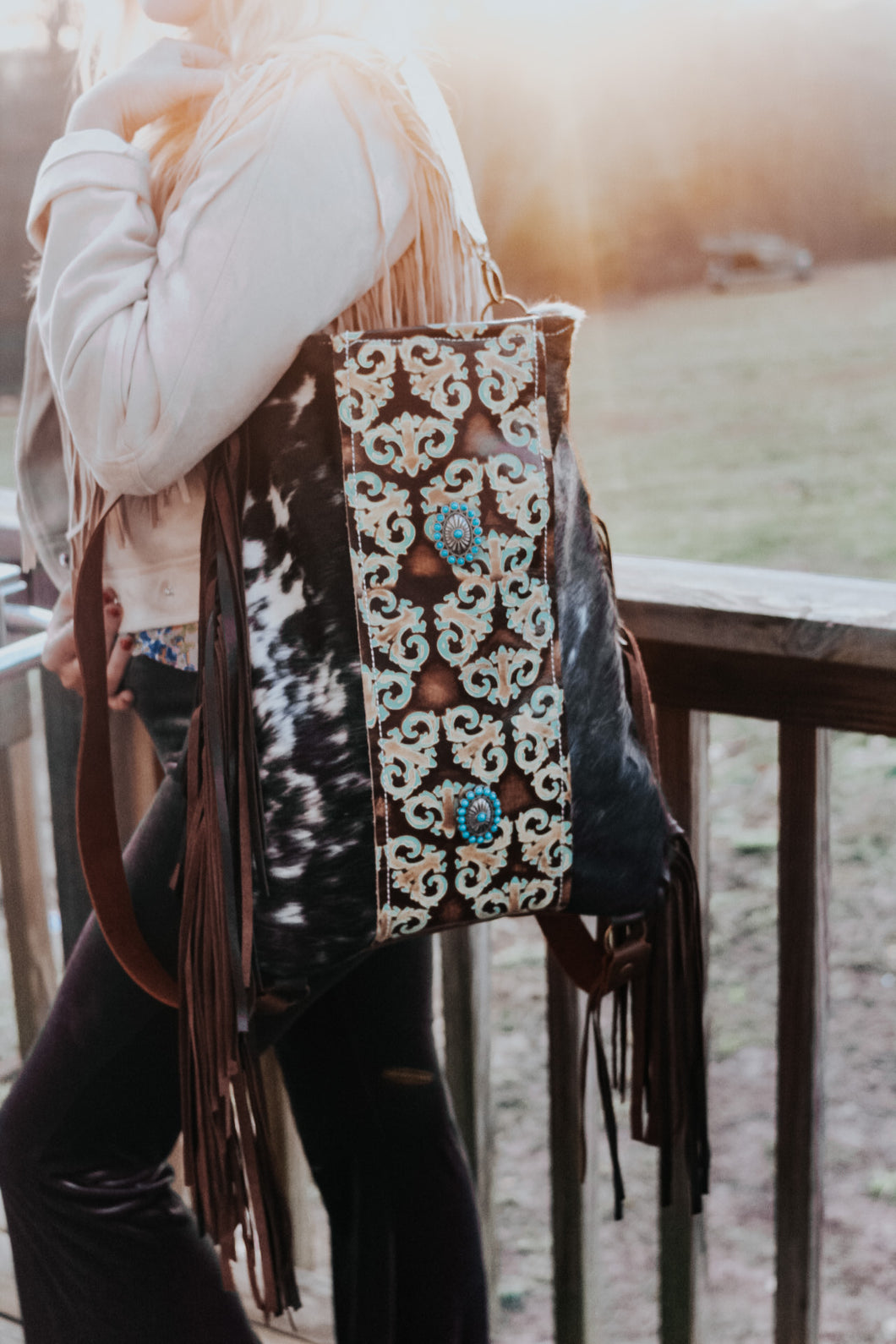 Turquoise Swirls and Black and White Hide Backpack