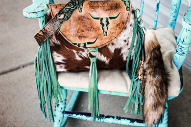 Tan/Turquoise Longhorn with Red Roan Juney