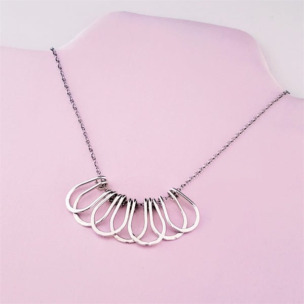 Sterling silver layered loop hammer finish bib style necklace