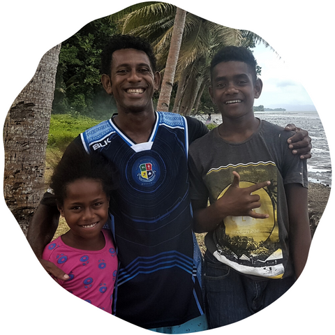 Sikeli mushroom and honey farmer in Suva, Fiji, with his family.