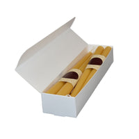 One case of Elegant, four pairs of dinner beeswax candles, 12 inches in height, with a golden to yellow color and a natural soft honey scent.