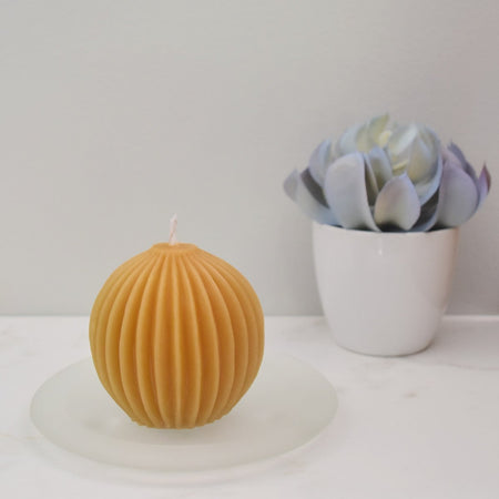 Yellow natural beeswax round fluted candle containing 100% beeswax
