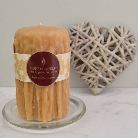 Creme coloured beeswax hand-dripped pillar candle for elegant occasions