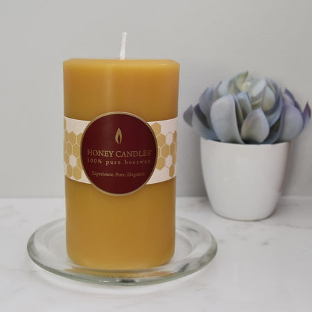 Yellow natural beewax pillar candle on kitchen counter